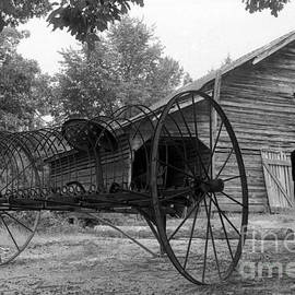 Old Hay Rake and Barn by Rodger Painter