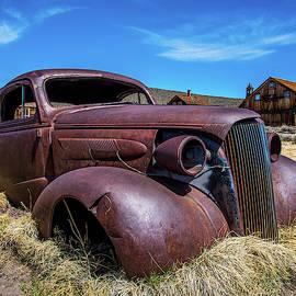 Old rusty car at Bodie by William Krumpelman