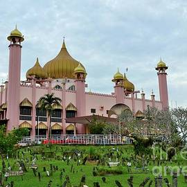 Old Sarawak State Mosque aka Masjid Lama Pink Mosque with graveyard Kuching East Malaysia by Imran Ahmed