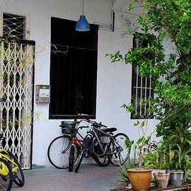 Old shop house with bicycles and windows on pavement Kampong Glam Singapore by Imran Ahmed