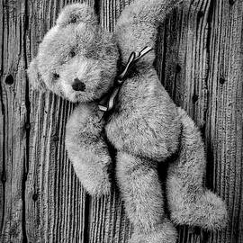 Old Teddy Bear Hanging On The Door In Black And White by Garry Gay