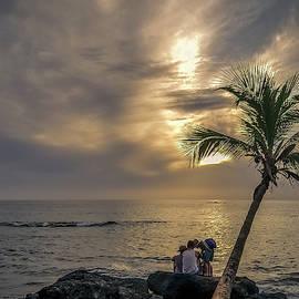 On the Rocks By the Ocean Watching Sunset by Srinivasan Venkatarajan