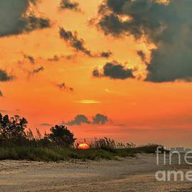 Orange Sunrise Over Sanibel Island by Jeff Breiman