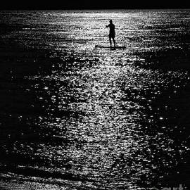 Paddleboarding In Silhouette by Jeff Breiman