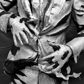 Painted mime artist showing frozen statue on the street, photo series 1. by Akos Horvath