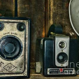 Pair of vintage cameras, a Afga Shur Shot and a Brownie Hawkeye. by Paul Ward