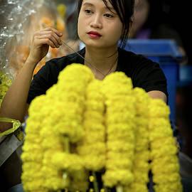 Pensive flower seller by Tony Camacho