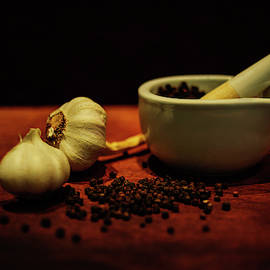 Pestle and Mortar with Garlic and Peppercorns by Cassi Moghan