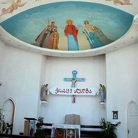 Pews pulpit statues and Jesus ceiling art Catholic Church of Holy Spirit Batumi Georgia by Imran Ahmed