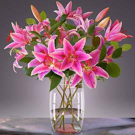 Pink Stargazer Lilies In Vase by David Arrigoni