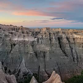 Pinnacles Overlook Sunrise Badlands National Park South Dakota by Joan Carroll
