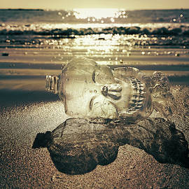 Plastic bottle on the beach by Masha Lince
