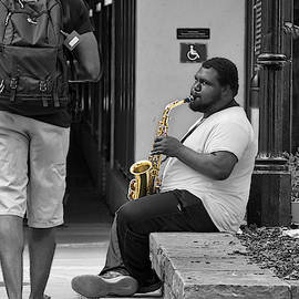 Playing Sax on River Walk by TJ Baccari