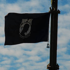 Pow-mia Flag Flying In With Breeze by Chris Flees