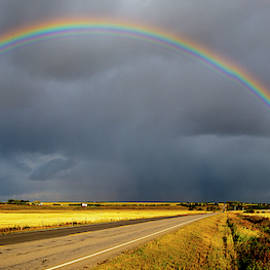 Rainbow Over Crop Land by Philip Rispin
