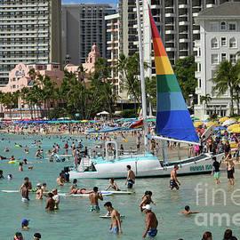 Rainbow Sailboat on Waikiki Beach by Colin Giles