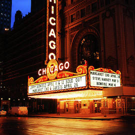 Rainy night at the Chicago Theater by James Kirkikis