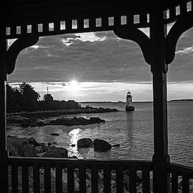 Red And Gold Sunrise Salem Ma Winter Island Fort Pickering Light From The Gazebo Black And White by Toby McGuire