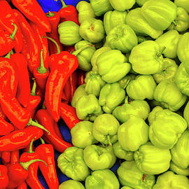 Red And Green Peppers In The Central Market by Steve Estvanik