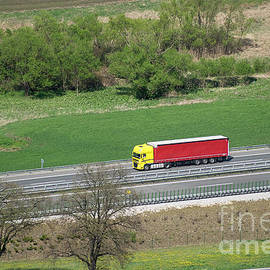Red And Yellow Truck by Les Palenik