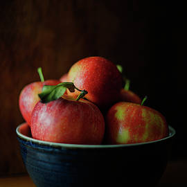 Red Apples in Blue Bowl by Cassi Moghan