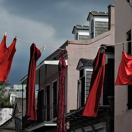 Red Dress Run Red Dresses Hanging On A Line In The French Quarter Of New Orleans by Michael Hoard