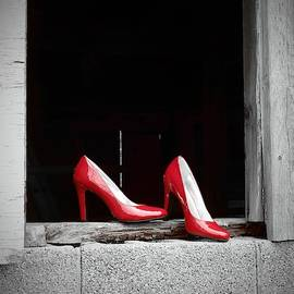 Red Shoes in Barn Window by Carmen Macuga