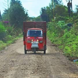 Red Tuk Tuk In Kenya by Marta Kazmierska