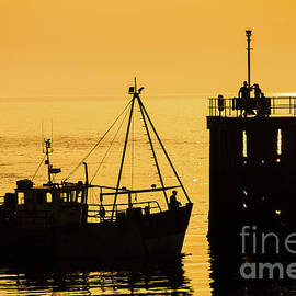Returning To Harbour At Dusk by Keith Morris