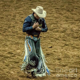 Rodeo Cowboy Dusting Off by Janice Pariza