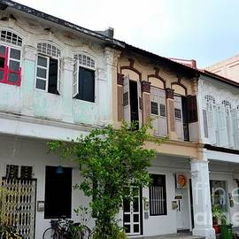 Imran Ahmed - Row of weathered shophouses with bicycles and windows Kampong Glam Singapore
