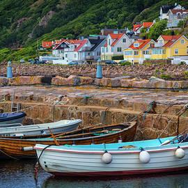 Rowboats at the Harbor Village by Debra and Dave Vanderlaan