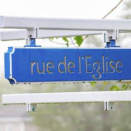 Rue de l'Eglise street sign by Marlin and Laura Hum