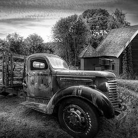 Rusty Truck in the Rural Countryside in Black and White by Debra and Dave Vanderlaan
