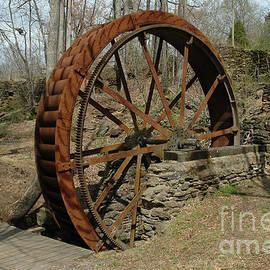 Rusty Waterwheel by Rodger Painter