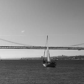 Sailboat Near 25 April Bridge, Lisbon by Alexandre Rotenberg