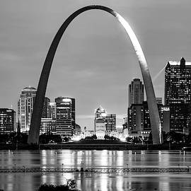 Saint Louis Skyline And Arch Over The Mississippi River - Black And White by Gregory Ballos