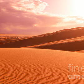 Sand dunes and clouds  by Jeff Swan