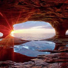 Sea Caves on Lake Superior at sunset by Alex Nikitsin
