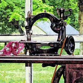 Sewing Machine In Window by Susan Savad