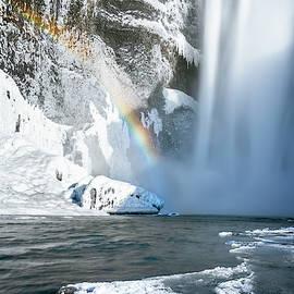 Skogofoss Waterfall And Rainbow by Joan Carroll