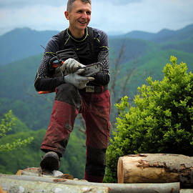 Slovenian Woodcutter by Lindley Johnson