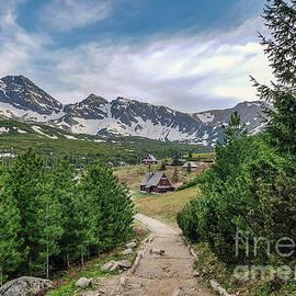 Small tiny wooden houses in Tatra mountains by Jekaterina Sahmanova