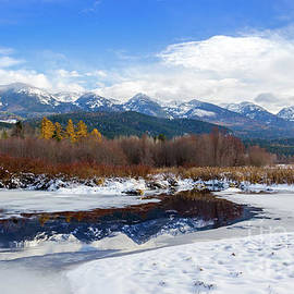 Snowy Flathead Lake and Mission Mountains in Montana by Amy Sorvillo