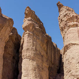 Solomon's Pillars In Timna Valley In The Negev Desert In Souther by William Kuta