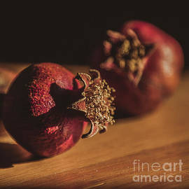 Still life with Couple of Dry Pomegranates on the wooden table,  by Rita Kapitulski
