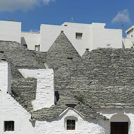 Stone Coned Rooves Of Trulli Houses by Steve Estvanik