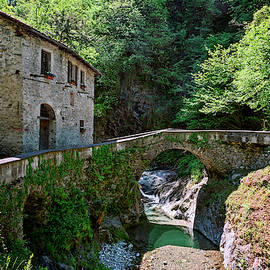 Stone House and Bridge Lake Como Italy by Joan Carroll