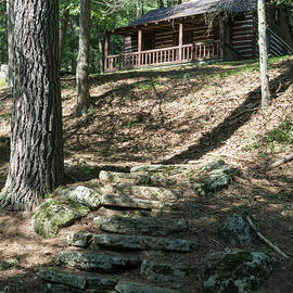 Stone Steps Lead Up Fo A Log Cabin For Guests At Lost River Stat by William Kuta