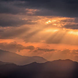 Sun Rays over the Mountains by Lindley Johnson